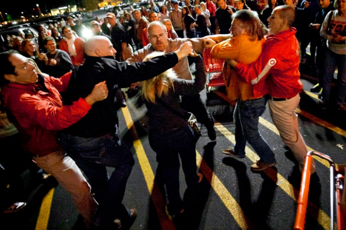 Security guards break up a fight between on Black Friday 2012.